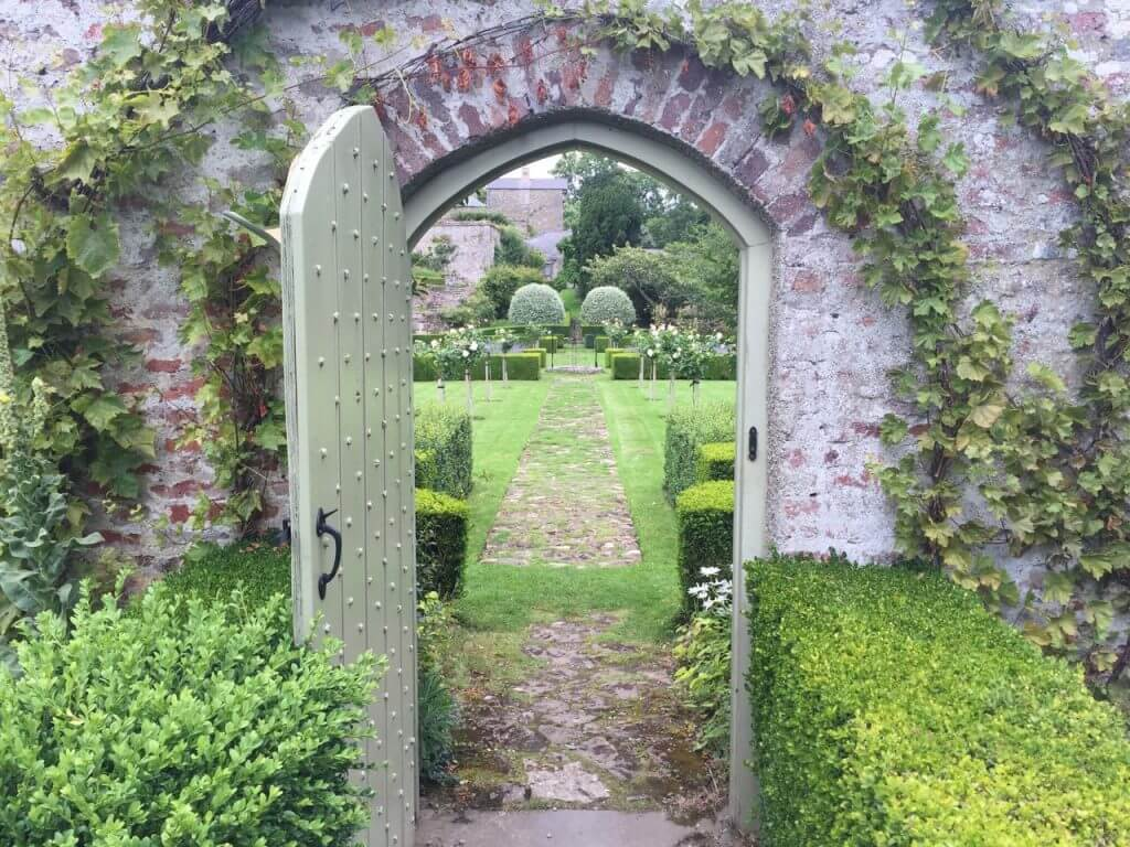 A romantic gate leading through to a garden