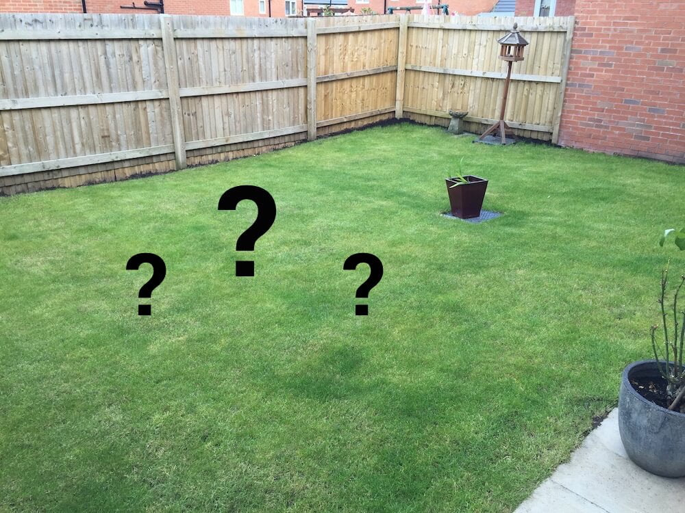 A new build back garden with question amrks on it