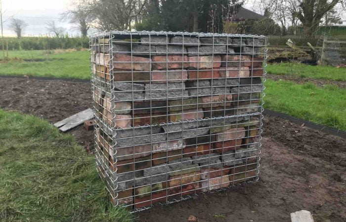 A full gabion box using reclaimed garden materials