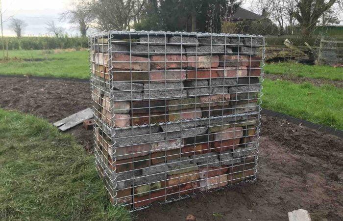 A full gabion box using reclaimed garden materials