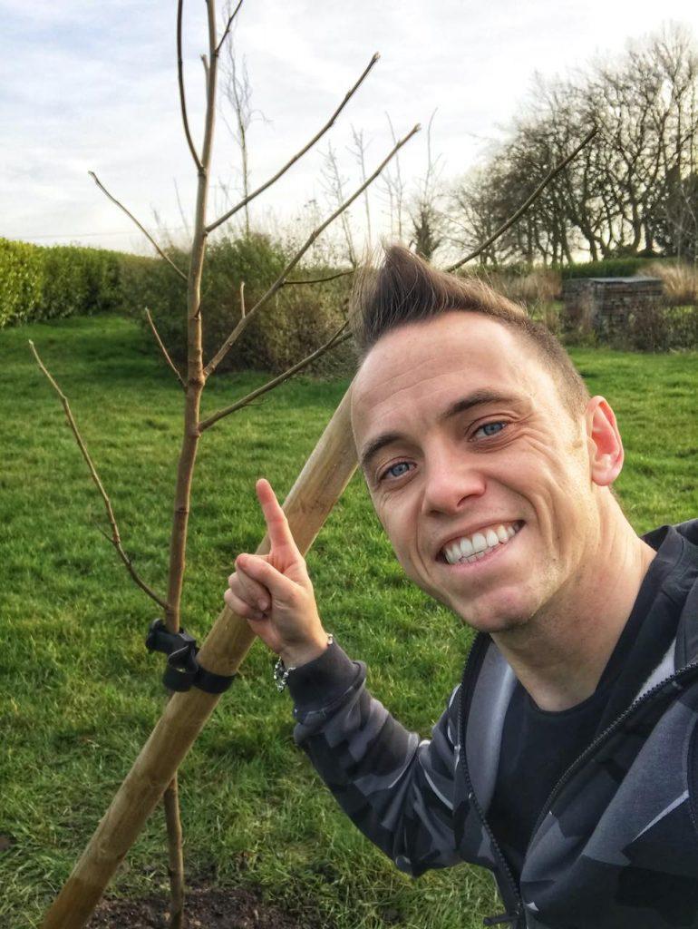 Garden Ninja next to a newly planted tree