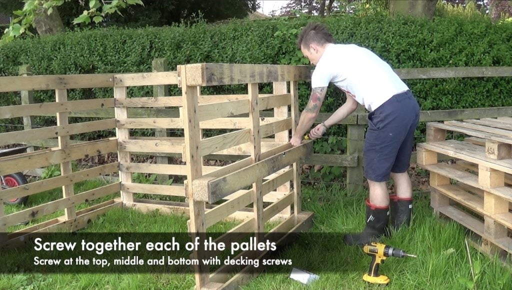 Screwing together a compost bin