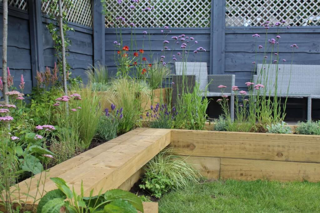 Integrated bench in a family friendly garden design by Garden Ninja
