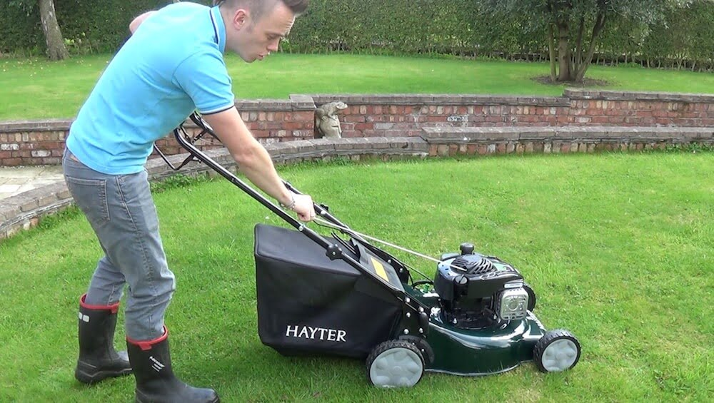 Lee Burkhill the Garden Ninja starting a Hayter Lawn Mower
