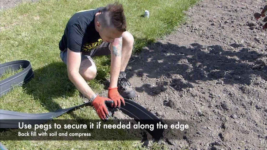 Garden Ninja fitting lawn edging in a garden
