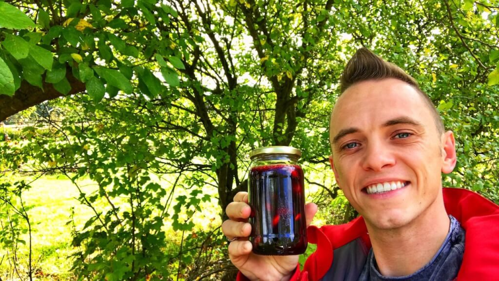 Garden Ninja holding a jar of Damson jam