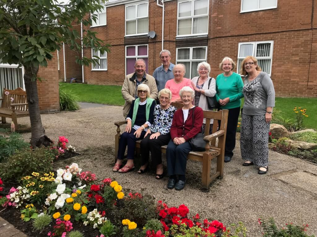 Community garden residents sat on a bench