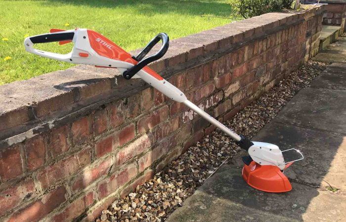 A Stihl strimmer against a wall