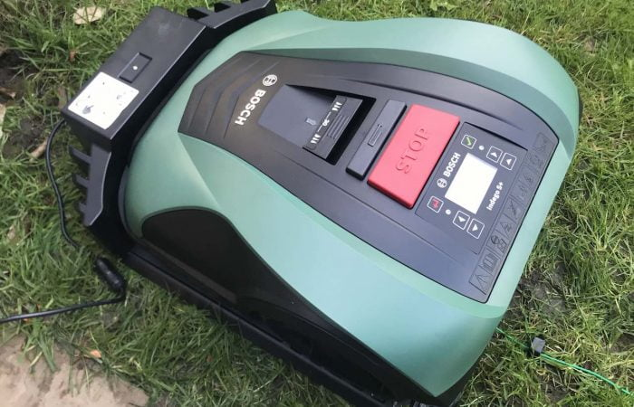 Green BOSCH robot mower on grass