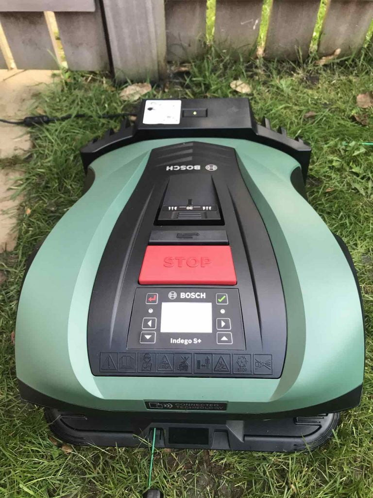 Bosch robo mower on its docking station