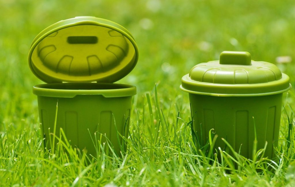 Green plastic buckets on turf