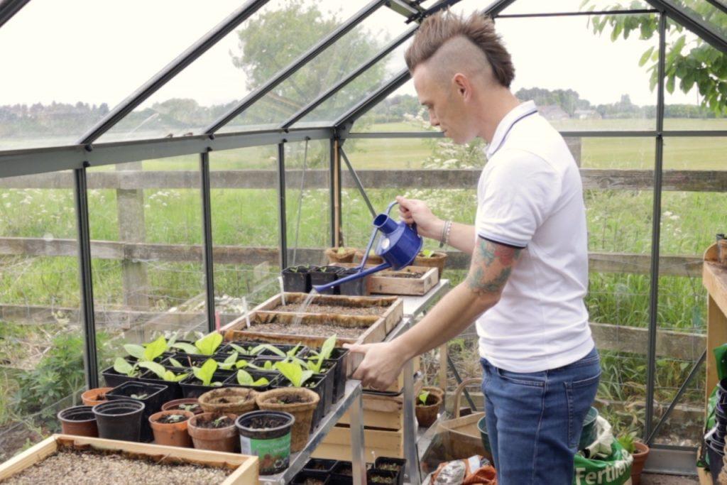 Garden Ninja watering a greenhouse
