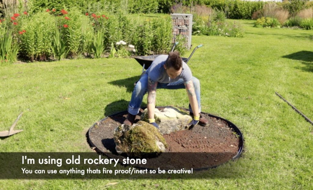 Adding stones to a fire pit