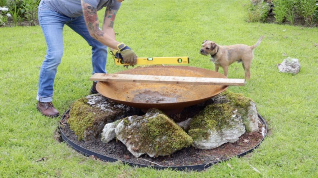 Checking a fire pit is level
