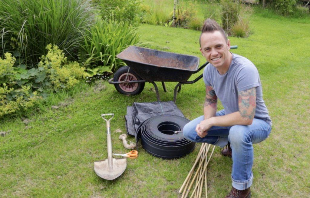 Garden Ninja next to a garden wheelbarrow
