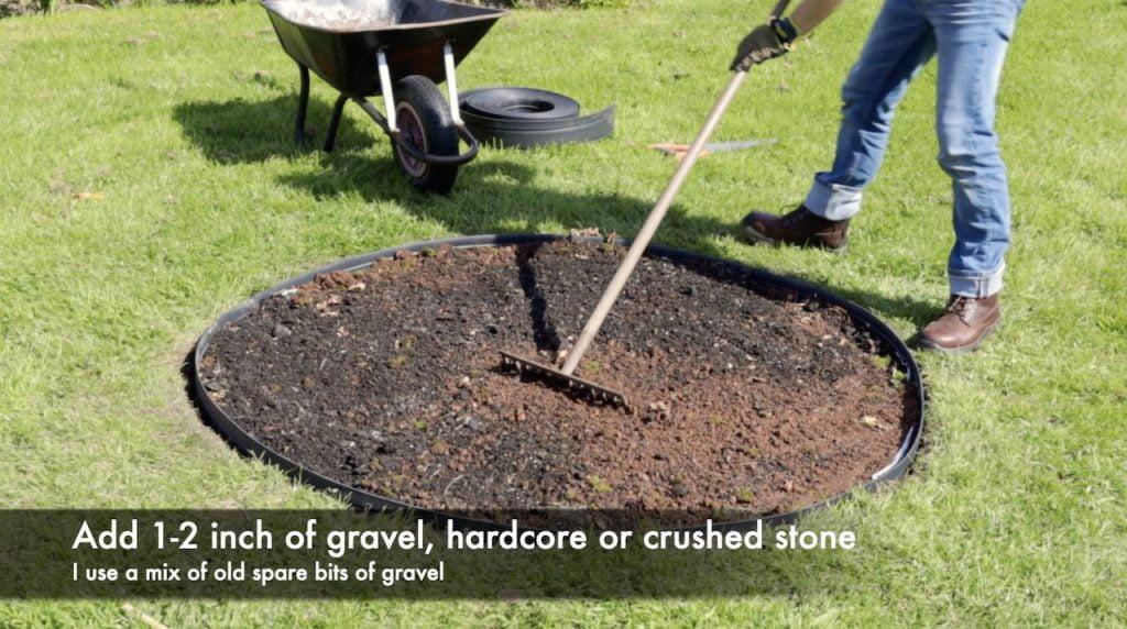 Garden Ninja raking a fire pit design