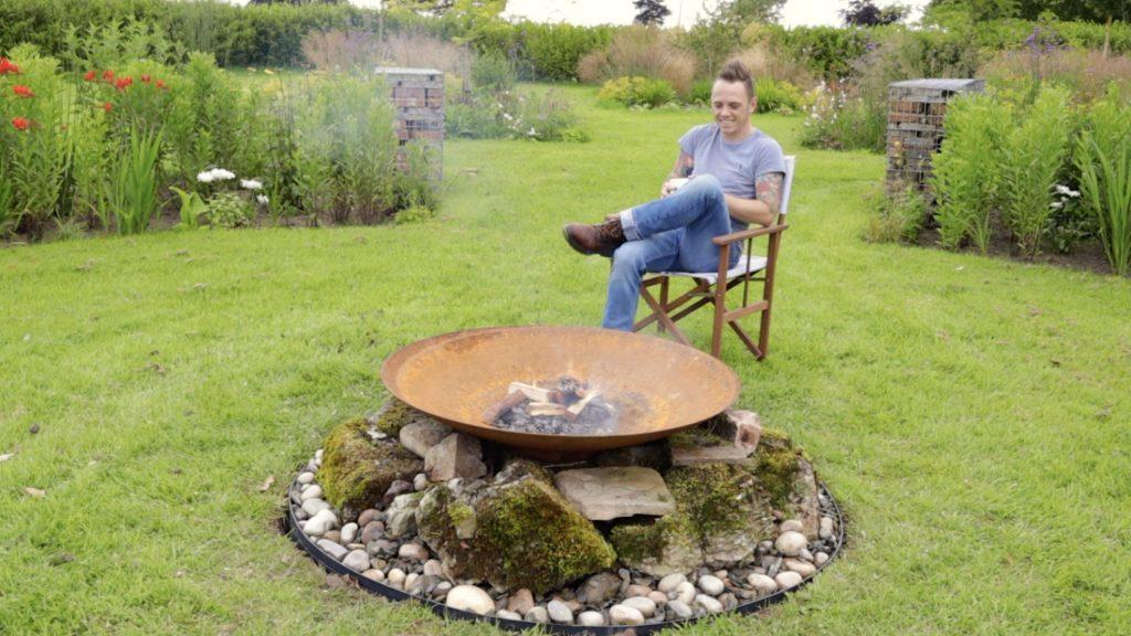 Garden Ninja sitting by a fire pit