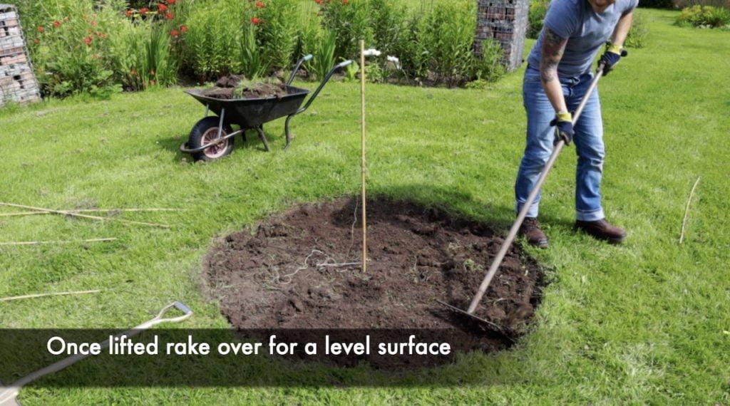 Garden Ninja raking a fire pit