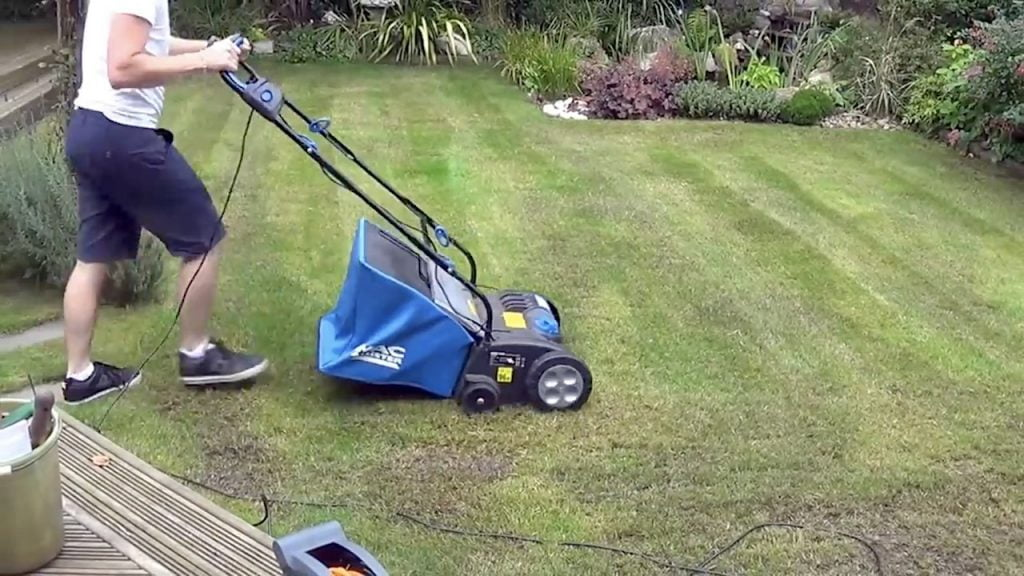 Scarifying a lawn with a powered scarifier