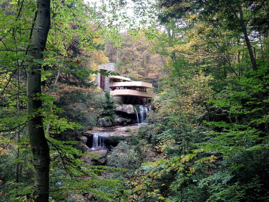 A modernist house and waterfall